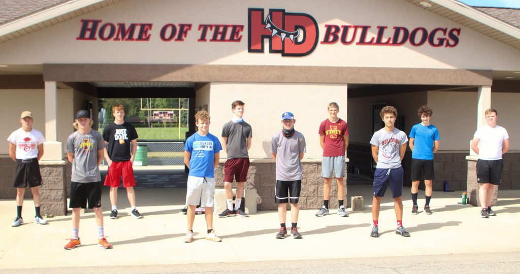 The 2020 Bulldog boys cross country team includes, front row, from left: Jack Showalter, Brandon Hisler, Marshal Rust, Jace Spurgeon. Back row: Andyn Showalter, Jonathan Simons,  Owynn McNutt, Eli Fink, Tam Hinden and Mickey Rosenberg. Not pictured: Zayden Erdman and Noah Shaver. (Kristi Nixon/Hampton Chronicle)